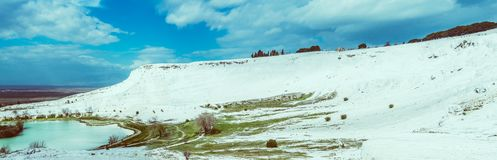 The mineral hillside of Pamukkale. The amazing hillside of Pamukkale was formed by mineral-rich water dripping down years after years, building the unique royalty free stock photography