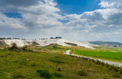 The mineral hillside of Pamukkale. The amazing hillside of Pamukkale was formed by mineral-rich water dripping down years after years, building the unique royalty free stock image