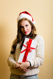 Amazing hipster girl in santa hat holding  a Royalty Free Stock Image