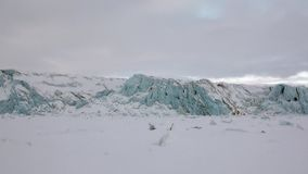 Amazing ice desert landscape in Arctic. Glacier of beautiful unique turquoise color on background of snow in Arctic. Amazing ice desert landscape. Silence quiet stock footage