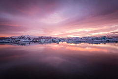 Amazing Iceland. Iceland, amazing sunset over the icebergs of the Jokulsarlon Glacier Lagoon. Long exposure and vanilla tones stock photo