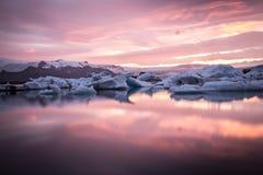 Amazing Iceland. Iceland, amazing sunset over the icebergs of the Jokulsarlon Glacier Lagoon. Long exposure and vanilla tones Royalty Free Stock Image