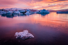 Amazing Iceland. Iceland, amazing sunset over the icebergs of the Jokulsarlon Glacier Lagoon. Long exposure and vanilla tones. Ice chunk on foreground stock photos