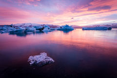 Amazing Iceland. Iceland, amazing sunset over the icebergs of the Jokulsarlon Glacier Lagoon. Long exposure and vanilla tones. Ice chunk on foreground royalty free stock photos