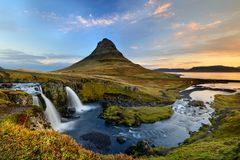 Amazing Icelandic landscape at the top of Kirkjufellsfoss waterfall with Kirkjufell mountain in the background Royalty Free Stock Image