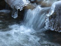 Amazing icicles on a small waterfall stock photos