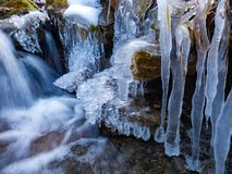 Amazing icicles on a small waterfall stock photo