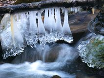 Amazing icicles on a small waterfall royalty free stock image