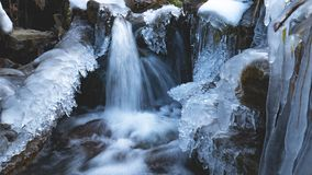 Amazing icicles on a small waterfall stock images