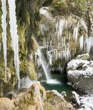 Amazing icicles and waterfall gorge on cold winter day. Hinanger Waterfall, Bavaria, Germany Royalty Free Stock Photo