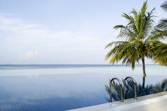 Amazing infinity pool in Maldives. Vilamendhoo Island. Indian Ocean Stock Photo