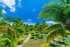 Amazing, inviting beautiful view of tropical garden at cayo Coco Cuban island Royalty Free Stock Photos