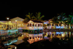 Amazing, inviting view of Memories Caribe hotel grounds lighted with various warm lights, reflected in water. Cayo Coco island, memories Caribe hotel, Cuba, June royalty free stock image