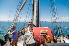 Amazing inviting view of people traveling on a tall ship in the lake Ontario Stock Photos