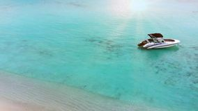 Amazing island in the Maldives ,Beautiful turquoise waters and white sandy beach with blue sky background for holiday stock video
