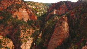 Amazing 4k aerial drone shot huge glorious american red orange sand stone cliff mountain range canyon sunset landscape