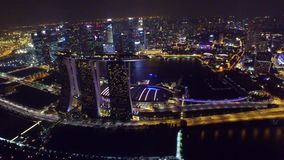 Amazing 4k aerial drone view on big city Singapore by ocean metropolis downtown in bright night light illumination stock footage