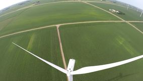 Amazing 4k aerial drone view on green eco farm windmill turbine field station of renewable energy source wind power farm. Amazing 4k aerial drone view on green stock video footage