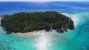 Amazing 4k aerial drone view on small tropical island in Tahiti French Polynesia turquoise Pacific ocean nature seascape. Amazing aerial drone view on small stock footage