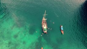 Amazing 4k aerial drone view on turquoise blue calm ocean water with tourist boats floating slowly in Singapore seascape stock video footage