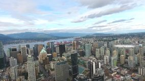 Amazing 4k aerial drone view on Vancouver modern architecture skyscraper by river downtown cityscape seascape skyline. Stunning aerial drone view on Vancouver stock video footage