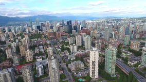 Amazing 4k aerial drone view on Vancouver modern architecture skyscraper by river downtown cityscape skyline seascape. Amazing aerial drone view on Vancouver stock video