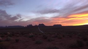 Amazing 4k view on Monument Valley Navajo Tribal national canyon park in Colorado Plateau, warm colorfun evening sunset stock video