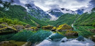 Amazing lake on a background of mountains and glacier. Norway. B royalty free stock photography