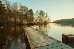 Amazing lake sunset. Forest sunset beautiful moment scandinavia Stock Photo