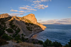 Amazing landscape of the Black Sea and mountain in Crimea. Beautiful sunset over the mountains and the sea Stock Images
