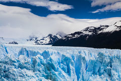 Amazing landscape with blue ice and mountains. Royalty Free Stock Photo