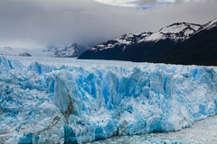 Amazing landscape with blue ice and mountains. Stock Images
