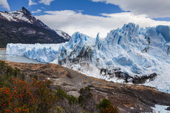 Amazing landscape with blue ice and mountains. Stock Image