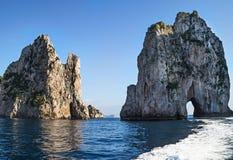 Amazing landscape at Capri Island with Faraglioni. Coastal rocks formation at the Mediterranean Sea royalty free stock photos