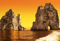 Amazing landscape at Capri Island with Faraglioni. Coastal rocks formation at the Mediterranean Sea. Creative style with color filter stock image