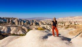 Cappadocia, day, Woman. Amazing landscape in country Turkey, Cappadocia area. Beautiful unusual unique rock. UNESCO world heritage. Summer impressive panorama royalty free stock image
