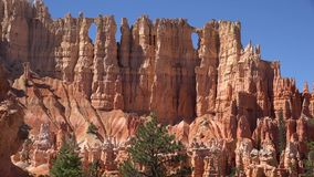 Amazing landscape 4k aerial shot of Bryce canyon national Utah tourist destination with rocky stone red mountain cliffs