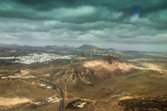 Amazing landscape with Lanzarote terrain and dark cloudy sky Stock Images