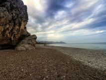 Amazing landscape of mountain near the sea with stone beach and blue sky. Olimpos beach, Turkey.  stock photography
