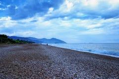 Amazing landscape of mountain near the sea with stone beach and blue sky. Olimpos beach, Turkey.  royalty free stock photos