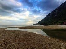 Amazing landscape of mountain near the sea with stone beach and blue sky. Olimpos beach, Turkey.  stock image