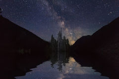 Amazing landscape with mountains and stars. Reflection of royalty free stock photo