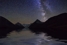 Amazing  landscape with mountains and stars. Reflection of Royalty Free Stock Images