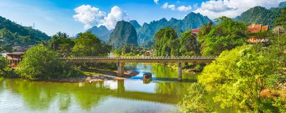 Amazing landscape of river among mountains. Laos. Panorama. Amazing landscape of Nam Song river among mountains. Bridge on the foreground. Pha Tang, Vang Vieng Stock Images