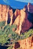Amazing landscape of orange mountains. Maravilloso paisaje de montañas anaranjadas con un verde horizonte. Ancient Roman mines. Big mountains in the Royalty Free Stock Images