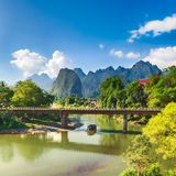 Amazing landscape of river among mountains. Laos. Amazing landscape of Nam Song river among mountains. Bridge on the foreground. Pha Tang, Vang Vieng district Royalty Free Stock Photo