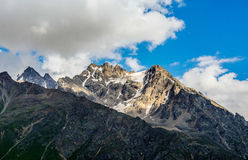 Amazing landscape of rocky mountains and blue sky, Caucasus, Russia royalty free stock photography