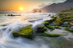 Amazing landscape sunset at papuma beach, indonesia Royalty Free Stock Photos