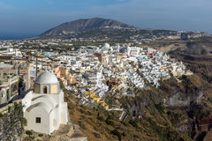 Amazing Landscape to town of Fira and Prophet Elias peak, Santorini island, Thira, Greece Stock Photos