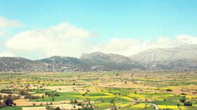 Amazing landscape valley with fields on the background mountains with blue sky Stock Photos